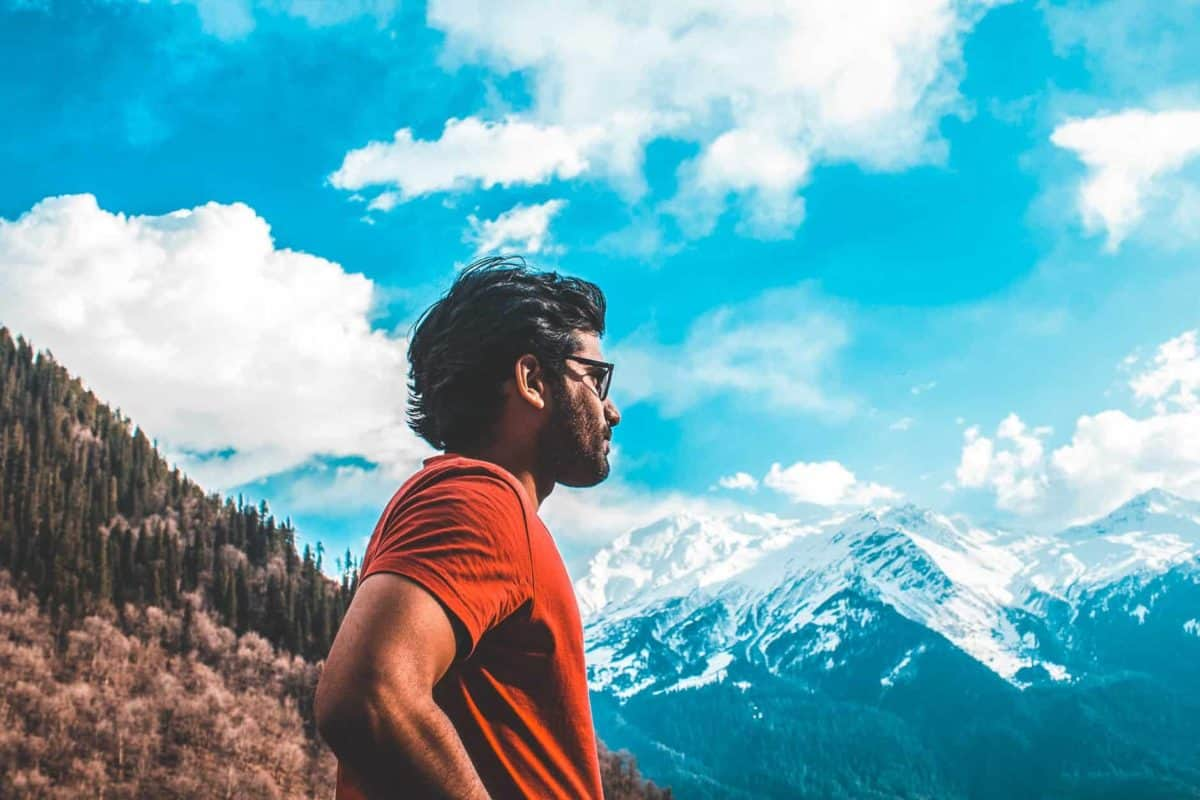 Man looking at mountains with sunglasses